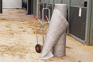 Absorbent sheeting for foot traffic and animal proof