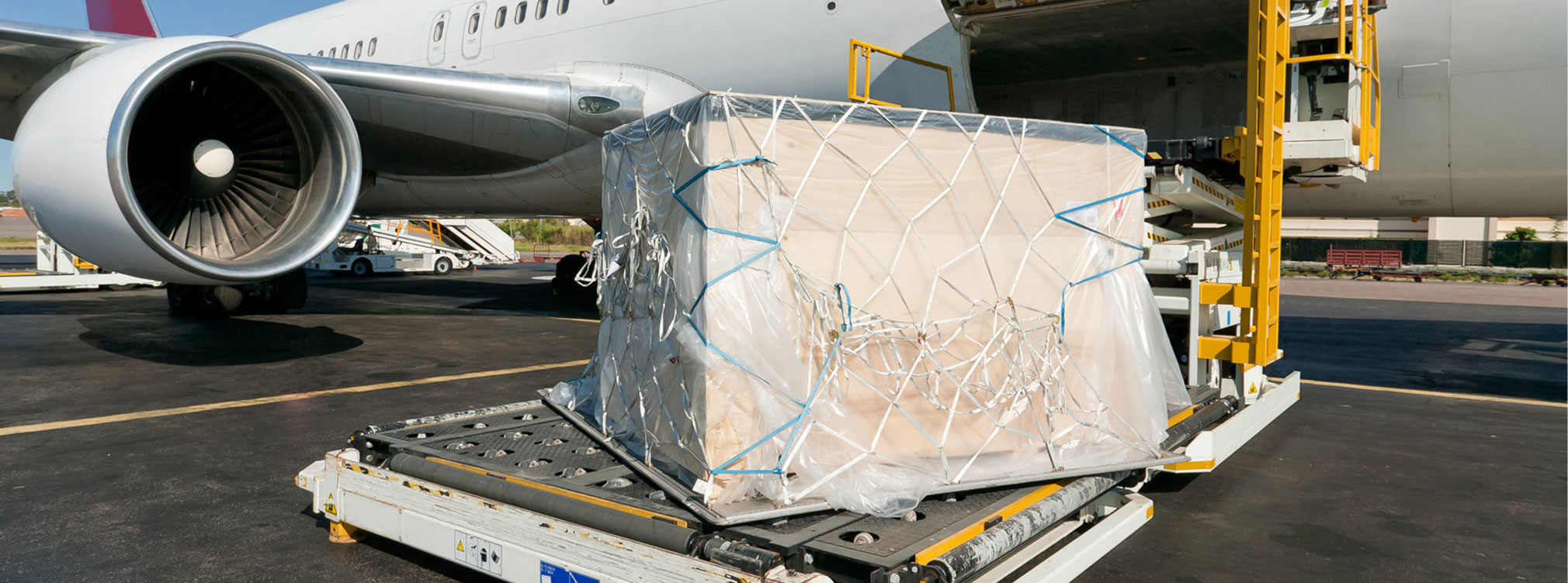 Extra wide polythene sheeting for protection of air cargo